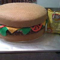 "Hamburger Groom's Cake This was our first groom's cake order... chocolate chunk cake with buttercream icing, RKT ""meat"", and fondant detail...."