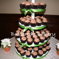 Wedding Cupcake Tower chocolate cake with dark chocolate ganache filling topped with chocolate buttercream.Sugar flowers on either side of the cake