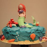 Ariel Mermaid Birthday Cake I made this Ariel birthday cake for a 5 yr old. I used cookie crumbs for the sand and blue tinted butter cream for the water. All the...