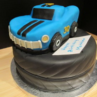 30Th Birthday Car And Tire Cake Carved vanilla pound cake on top and chocolate cake on the bottom. All parts are edible. Tires are RKT. 30th birthday for a muscle car dude...