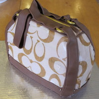Coach Purse edible images on sides. This looked great but later turned into my first cake disaster when the frosting sheets never really melted into...