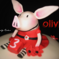 Olivia The Pig! This cake was inspired by the Cake Central community. Thank you so much, we had a lot of fun figuring this one out!