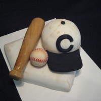 1909 Chicago Cubs This cake was done as a surprise to a great friend of ours, who is a HUGE Cubs fan. The hat and base are German Chocolate cake, and the bat...