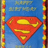 Superman's Crest Yellow cake with buttercream icing.