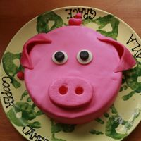 Oink Oink I made this as a practice cake. My friend wants a pig cake for her father inlaw's 59th birthday, and since I have only made 6 cakes...