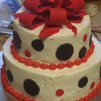 Red & Black Polka Dots Buttercream with fondant dots and bow.