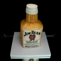 "Jim Beam 4 6"" cakes stacked (with Jim Beam cream between each). I carved the top on a slant and then cut off the sharp corners. Then covered..."
