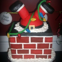 "Santa's Strung!  I've seen a few of these ""Santa's stuck"" cakes on here, so thank you all for inspiration! This cake was pretty big......"