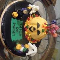 Trick Or Treat! This is the second cake I had to bake for this. The first one, I cut the grooves for the pumpkin WAY too deep and the whole cake basically...
