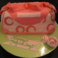 First Purse Cake!! I am so pleased with it. Lots of things I could have done but will do next time. Thanks to She-She's pic here on CC and all the other...