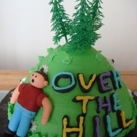 Over The Hill For a 50th birthday. Guy made out of fondant.
