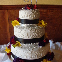 Scroll Wedding Cake It is a marble cake with bavarian cream, strawberry and b/c filling for the different layers.