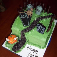 50Th Halloween Bash Buttercream frosting, fondant coffin, candy for picket fence.