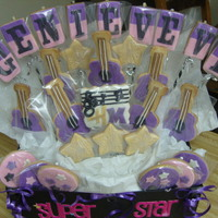 Hannah Montana Themed Bouquet Made these for my husband's 6 year old niece. NFSC and fondant. Guitars were hand cut - no cookie cutter on hand at the time. Thanks...