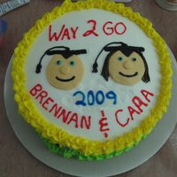 Brennan & Cara Graduate 6Th Grade   A cake for my neice & nephew.....white cake with buttercream...nothing fancy...I'm only 3 months into this deal but loving it!