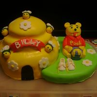 Winnie The Pooh Cake This cake was made for my niece Caroles baby shower it was a big hit...And it was my very first fondant cake...