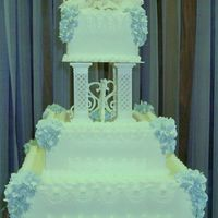 Wedding Cake  I designed this cake. The bottom borders are rosettes and fence borders. The top borders are reverse shell coupled with scalleps and lots...