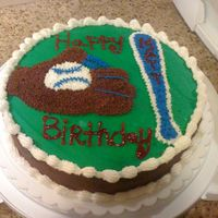 Baseball Birthday Cake Chocolate cake with reese's pieces chips, chocolate and vanilla butter cream.