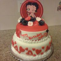 Betty Boop Cake This is my first fondant covered cake I made for a little girls 10th Birthday. Bottom tier is a 10 inch red velvet cake with vanilla butter...