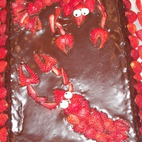 Strawberry Lobsters Chocolate cake covered with chocolate ganache with strawberries assembled into lobsters!Groom's cake. Couple's pet name for each...