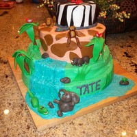 Jungle Cake Inspired by 4 or 5 Jungle/Safari cakes here on Cake Central!MMF animals were a blast to make.