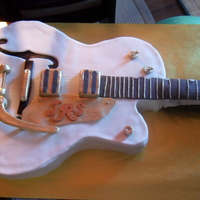 Guitar Wedding Cake Gretsch Falcon When my best friends said they were getting married after 13 years, I told them I would make them the wedding cake and the bride being in a...