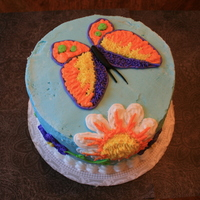 Wilton Lesson 1-Original Design Thankfully I was able to do my own design for the first cake instead of the rainbow. Getting buttercream is not an easy thing to do. I...