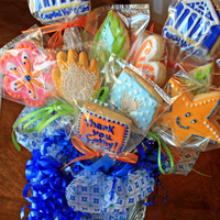 My First Cookie Bouquet Gran Marnier Sugar Cookies with company logo and thankyou in appreciation for their referrals.