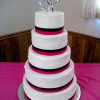 Hot Pink Wedding This cake was inspired by Fairytale's cake. All buttercream except for real ribbon used.