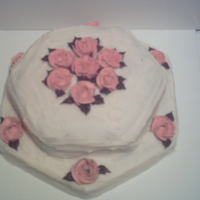 Mary's Birthday Italian cream cake with cream cheese icing. Pink roses and brown leaves are made of buttercream.