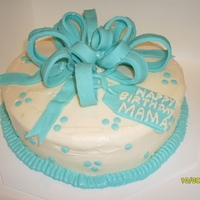 Mama's Birthday Carrot cake, cream cheese frosting. Decorations made of fondant