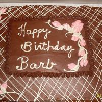 Happy Birthday Barb!!! Chocolate/orange cake with chocolate buttercream frosting. White chocolate lines and writing, buttercream flowers