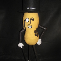 Mr. Peanut Anniversary Cake I was asked to make one regular anniversary cake and one Mr. Peanut cake for the party and this is what my husband and I came up with. This...