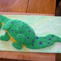 "Dinosaur Birthday Cake This cake is from the Wilton site. It is the ""Docile Dragon"" but my son likes dinosaurs, so I made a couple of changes. The cake..."