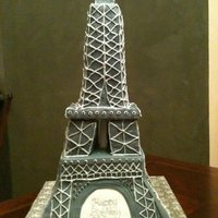 Eiffel Tower Cake Bottom tier is vanilla bean cake with layers of vanilla custard and chocolate ganache filling, covered in fondant. The tower is RKT covered...