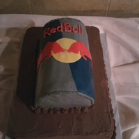 Red Bull Groom's Cake Dark Chocolate Cake with Cheesecake filling and Chocolate Buttercream. Red Bull can is covered in Rolled Fondant.