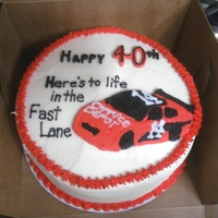 Life In The Fast Lane... Birthday cake for a co-worker...white cake with buttercream icing. Race car is frozen buttercream transfer.
