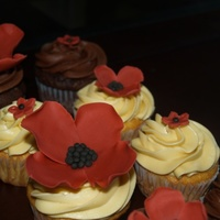 Birthday Cupcakes BC/fondant flowers made to match napkins for birthday celebration. TFL.