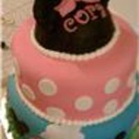 Cora's Minnie Mouse Cake  wasc cake and chocolate cake. all bc and covered and decorated w/ mmf. made the little hat out of rice krispies treats and covered w/ mmf...