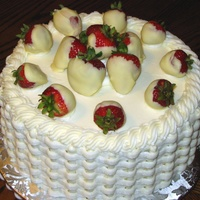 Strawberry Basket strawberry cake w/ creamcheese frosting and white choc. covered strawberries