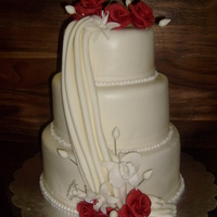 Wedding Cake red and white roses, lilies, vanilla cake with a cream cheese filling