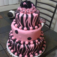 Black And Pink Zebra Cake chocolate cake with fresh strawberry filling covered in marshmellow fonfant! topped with black roses