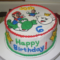 Mario Cake My nephew's love having their pictures on their cakes, so this one had my nephew's face on it. He loved it!