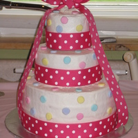 "Polka Dot Birthday Cake Made for a 1st birthday party. iced in buttercream with fondant polka dots. 9"" bottom, 6"" middle, and 4"" top tier. The top..."
