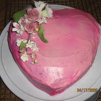 Heart & Flowers I made this for my mom's birthday. Simple, but she still loved it. The frosting was regular vanilla frosting and I used the pink spray...