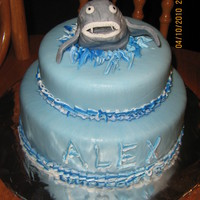 Shark I admit, I'm horrible at coming up with ideas, as I found a few shark cakes on here and jammed the ideas I got together to make this....
