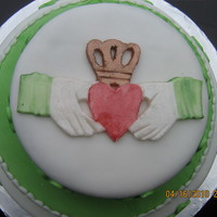 Irish Claddagh & Shamrocks I made this for a friends moms birthday. Everything is fondant and I used shimmer powder to paint the claddagh. The cake is devil's...