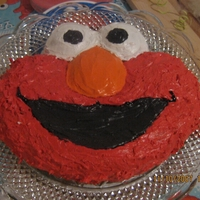 Elmo used the cake pan, but I'm still proud of the way I decorated it. It was for my daughter's second birthday.