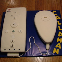 Wiimote And Nunchuk Chocolate and vanilla cakes covered in homemade fondant. Gumpaste and 50/50 details. Thanks to all the great photos on here for ideas!