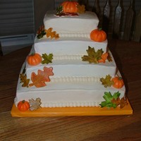 Fall Birthdays Pumpkin and caramel vanilla cakes covered in cream cheese buttercream frosting. The leaves are gumpaste and the pumpkins are MMF. This was...